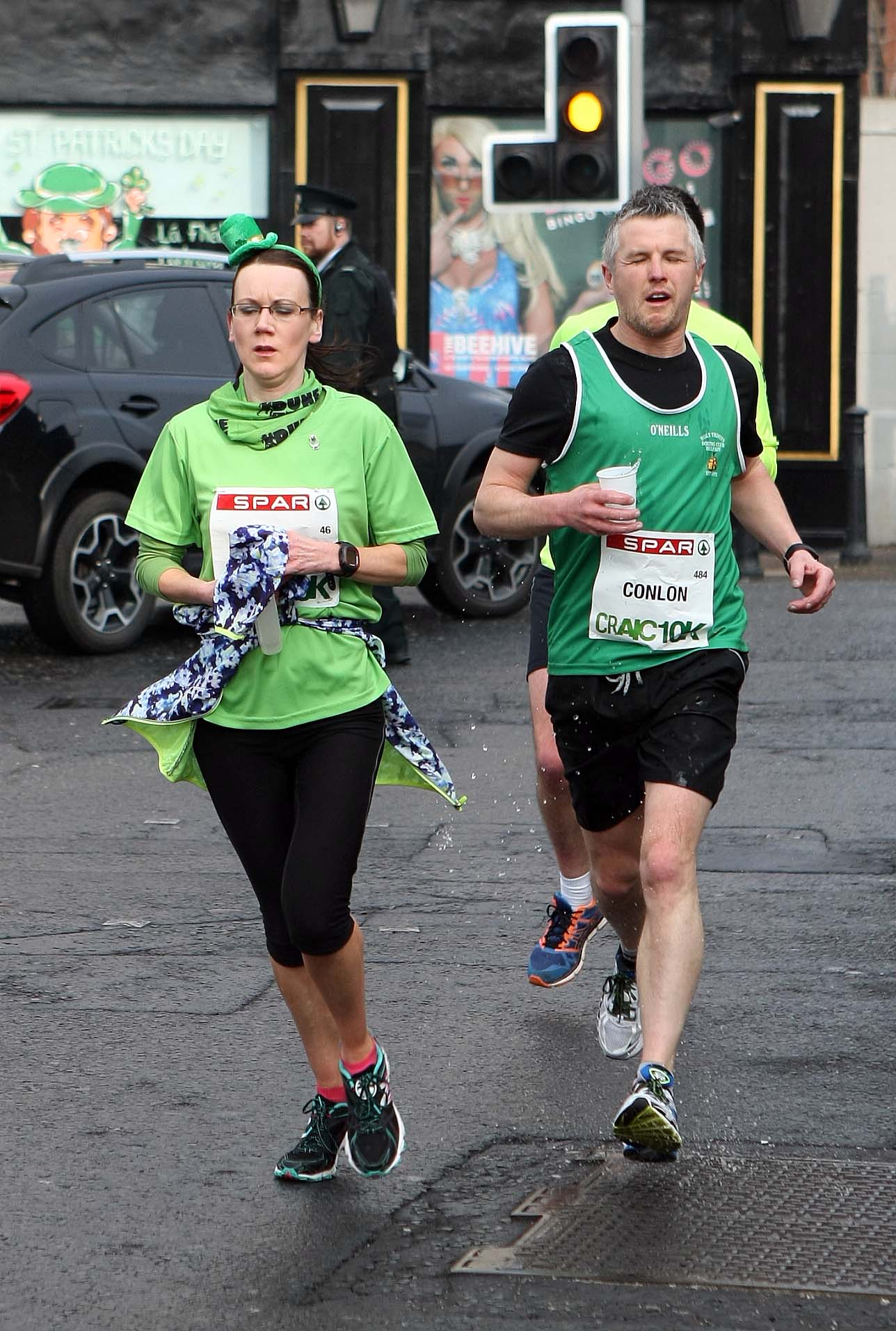 Tuesday 17-3-2015St Patrick's DaySPAR Craic 10k BelfastTaking on water at the BeehiveSparCraic10K170315FP006